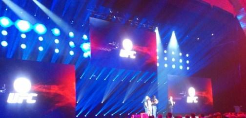 Dana White, Jon Jones, and Benson Henderson onstage for EA Sports UFC.