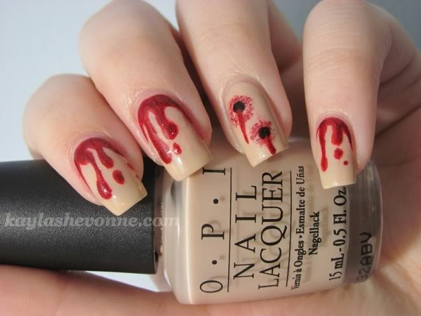 The ten scariest nail art designs for halloween nerdy but flirty i like the detail of one nail having vampire bite marks the craftsmanship on those bite marks is pretty amazing too also instead of blood dripping from prinsesfo Gallery