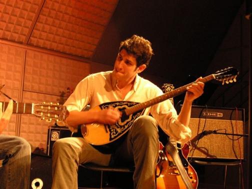 Zach-performing-on-bouzouki-in-Athens-Greece