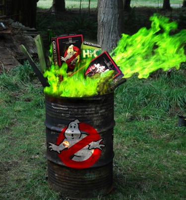 Barrel fire with ghostbusters merchandise inside